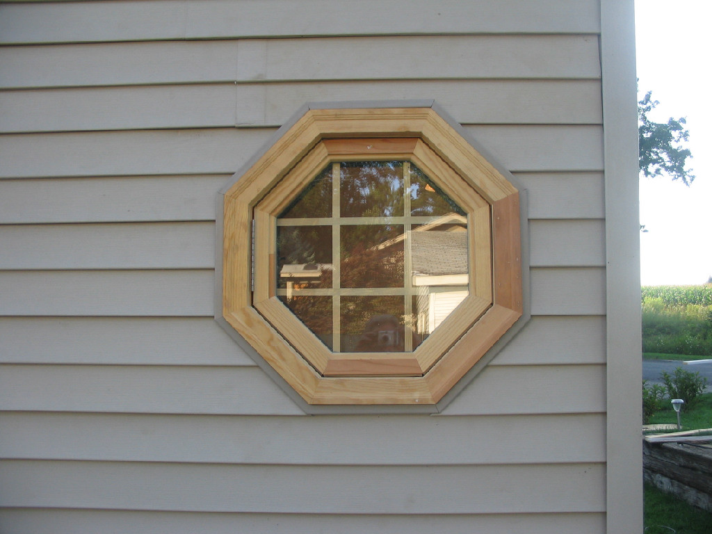 Octagonal window with wooden framing